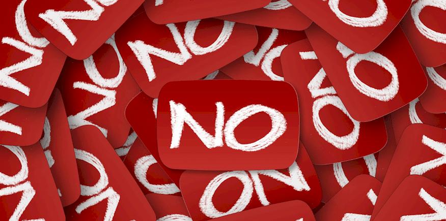 """Symbilbild: viele Schildchen mit der Aufschrift """"No"""": Wurde Ihr Unterweisungskonzept innerhalb der Ausbilderprüfung negativ bewertet?"""