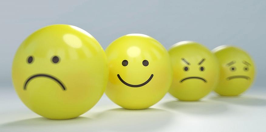 Symbolbild: vier gelbe Bälle mit unterschiedlichen Smileys