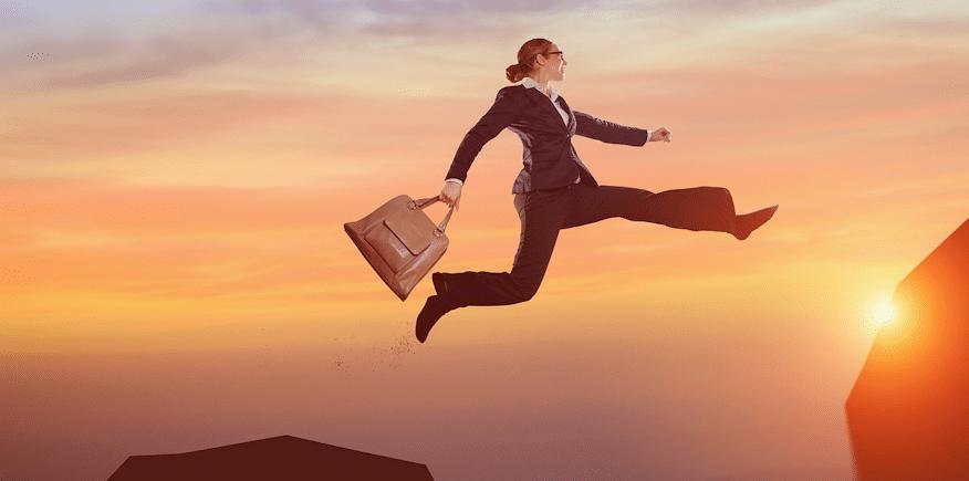 Symbol für Umschlung: springende Business-Frau